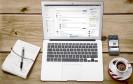 Macbook mit Kaffee, eXo Platform und Notizbuch