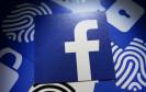 Facebok-Logo mit Fingerabdrücken